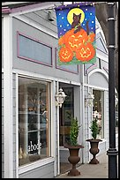 Storefront on Main Street with Halloween street decor. Half Moon Bay, California, USA