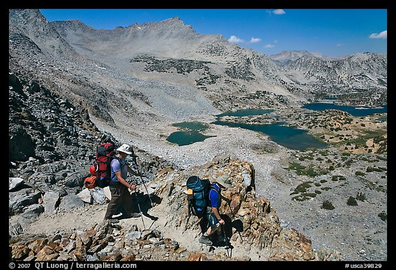 Backpackers descending from Bishop Pass, John Muir Wilderness. California, USA (color)