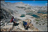 Backpackers going down from Bishop Pass, John Muir Wilderness. California, USA (color)
