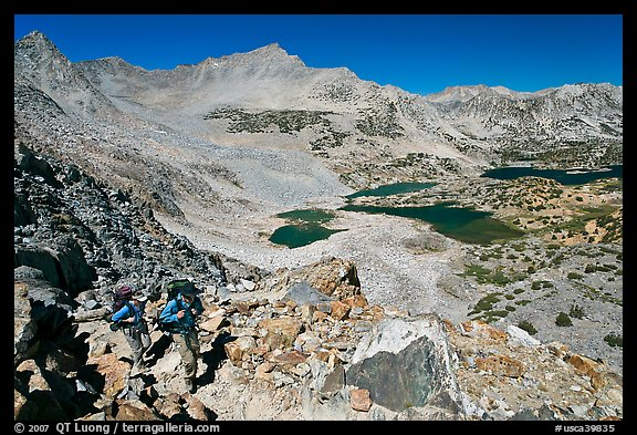 Backpackers hiking up from Saddlebag Lakes, John Muir Wilderness. California, USA