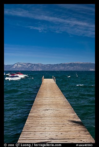 Dock, small boats, and blue waters, West shore, Lake Tahoe, California. USA