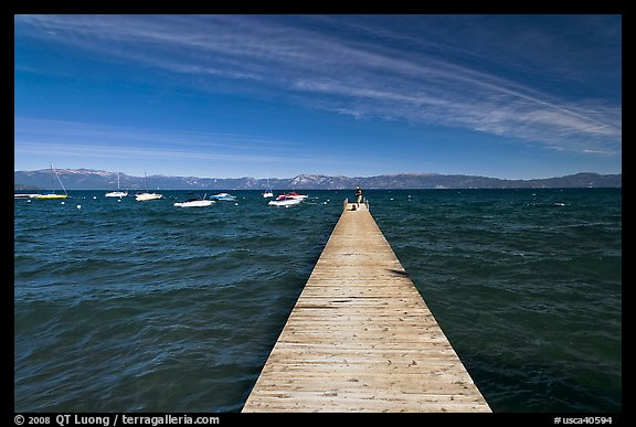 Dock, small boats, and blue waters and mountains, Lake Tahoe, California. USA (color)