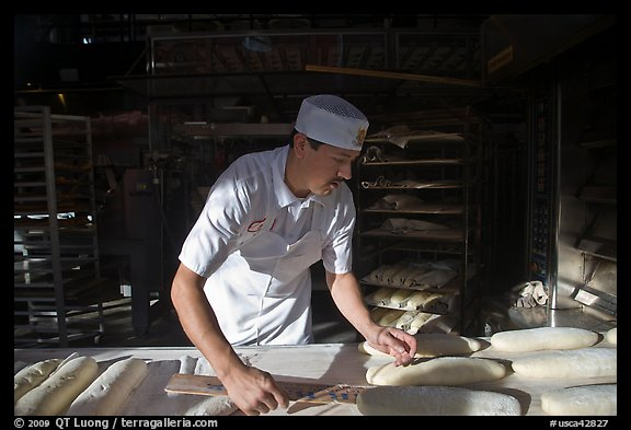 Baker preparing San Francisco sourdough bread. San Francisco, California, USA (color)