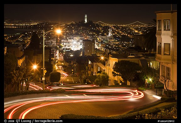 Sharp switchbacks on Russian Hill with Telegraph Hill in the background, night. San Francisco, California, USA (color)