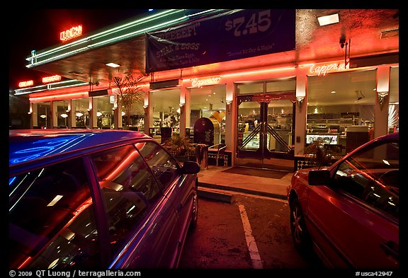 Cars and neon light of dinner at night. San Francisco, California, USA (color)