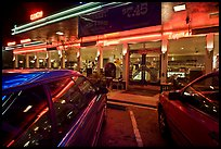 Cars and neon light of dinner at night. San Francisco, California, USA