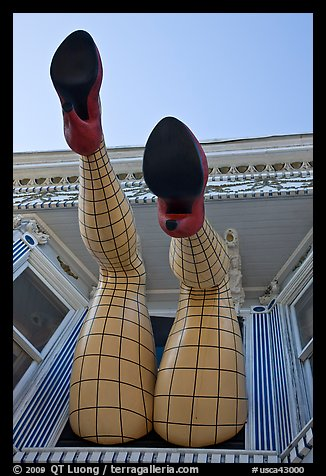Legs with fishnet stockings hanging from a window, Haight-Ashbury District. San Francisco, California, USA (color)