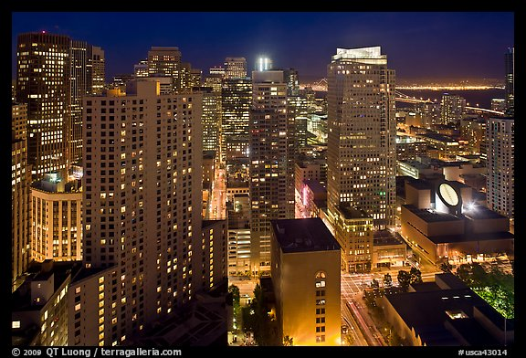 High-rise buildings and SF MOMA at night from above. San Francisco, California, USA (color)