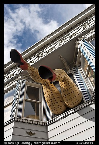 Giant legs with stockings hanging from a second floor, Haight-Ashbury District. San Francisco, California, USA (color)
