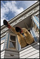 Giant legs with stockings hanging from a second floor, Haight-Ashbury District. San Francisco, California, USA ( color)
