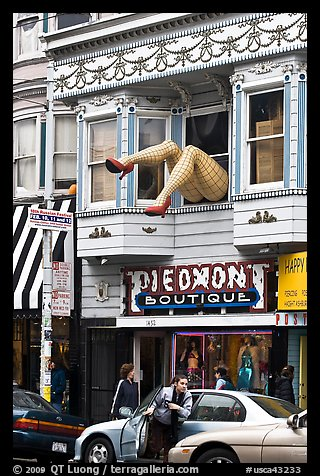 Woman exiting car below women legs with stockings. San Francisco, California, USA (color)
