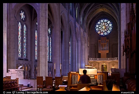 Church organist playing inside Grace Cathedral. San Francisco, California, USA (color)
