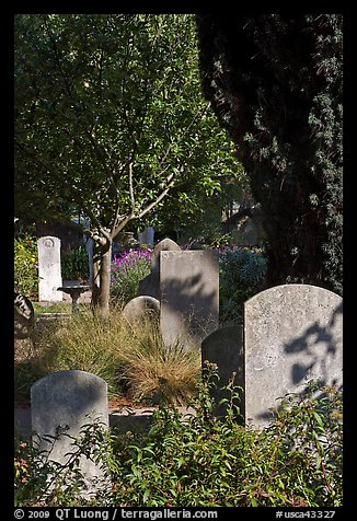 Headstones in the garden of Mission San Francisco de Asis. San Francisco, California, USA (color)