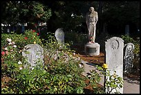 Gravestones and statue, Mission Dolores. San Francisco, California, USA (color)