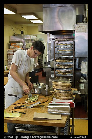 Man preparing pizza, Haight-Ashbury district. San Francisco, California, USA (color)
