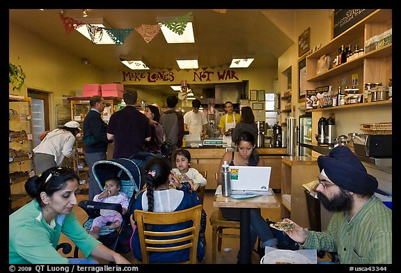 Indian family inside popular pizza restaurant, Haight-Ashbury district. San Francisco, California, USA (color)