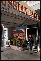 Russian Bakery with redhead woman walking out. San Francisco, California, USA (color)