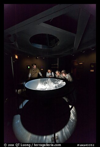 Tourists look at moving image of ocean inside the Camera Obscura, Cliff House. San Francisco, California, USA (color)
