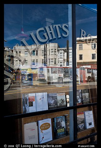 City Light Bookstore storefront with street reflections, North Beach. San Francisco, California, USA (color)