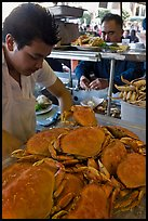 Man preparing crabs, Fishermans wharf. San Francisco, California, USA