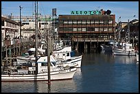 Aliotos restaurant and fishing fleet, Fishermans wharf. San Francisco, California, USA (color)