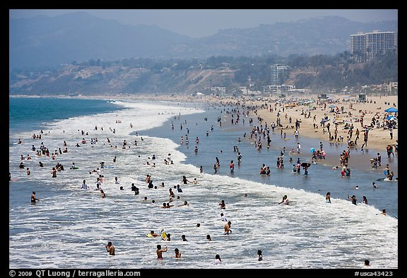 Many People Bathing In Surf At Santa Monica Beach Los Angeles California Usa