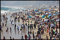 Dense crowds on beach. Santa Monica, Los Angeles, California, USA (color)