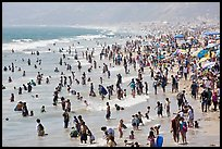 Crowds of beachgoers in water. Santa Monica, Los Angeles, California, USA ( color)