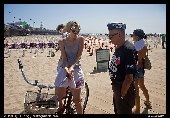 Veteran for peace conversing with woman on bicycle. Santa Monica, Los Angeles, California, USA (color)