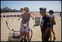 Veteran for peace conversing with woman on bicycle. Santa Monica, Los Angeles, California, USA ( color)