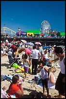 Families on beach and Pacific Park on Santa Monica Pier. Santa Monica, Los Angeles, California, USA (color)