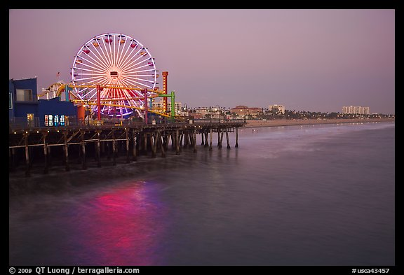 Ferris Wheel and beach at dusk, Santa Monica Pier. Santa Monica, Los Angeles, California, USA (color)