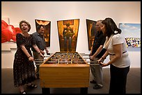 Playing soccer table game in art gallery, Bergamot Station. Santa Monica, Los Angeles, California, USA (color)