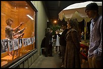 People watch performance artists in window, Bergamot Station. Santa Monica, Los Angeles, California, USA ( color)