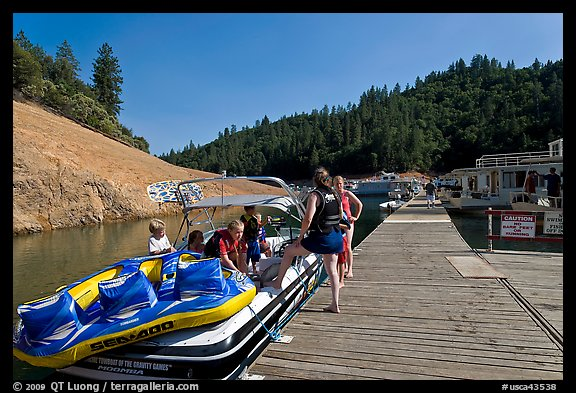 Deck with family preparing a boat, Shasta Lake. California, USA (color)