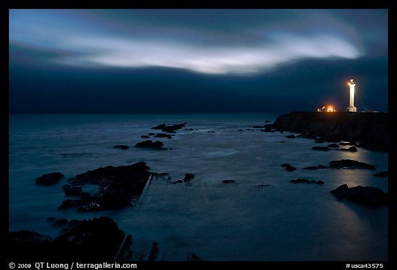 Night coastal scene with ocean and Lighthouse, Point Arena. California, USA (color)