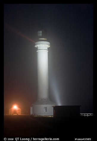 Point Arena Lighthouse on foggy night. California, USA (color)
