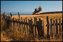 Fences, summer grass and chapel towers, Fort Ross. Sonoma Coast, California, USA ( color)