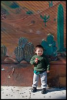 Boy and mural, Mission District. San Francisco, California, USA (color)