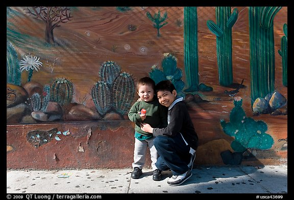 Boys and mural, Mission District. San Francisco, California, USA (color)