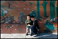 Boys and mural, Mission District. San Francisco, California, USA ( color)