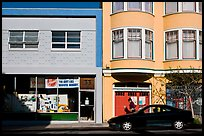 Street with brighly painted buildings, Mission District. San Francisco, California, USA (color)