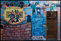 Political mural and door, Mission District. San Francisco, California, USA (color)
