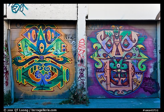 Two painted garage doors, Mission District. San Francisco, California, USA (color)