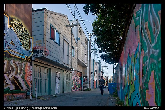 Man walking in alley, Mission District. San Francisco, California, USA (color)