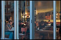 Cafe seen through windows, Mission District. San Francisco, California, USA (color)