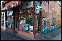 Corner store and mural, Mission District. San Francisco, California, USA (color)