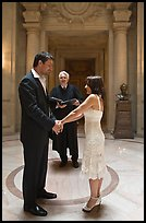 Bride, groom, and wedding officant, City Hall. San Francisco, California, USA (color)