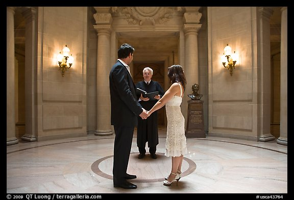 Couple taking marriage wows, City Hall. San Francisco, California, USA (color)