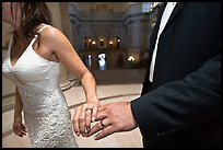 Newly wed couple holds hands, showing ring, City Hall. San Francisco, California, USA (color)